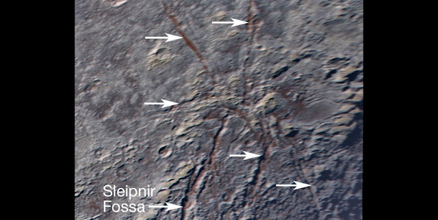 Pluto's unusual spider-like feature consists of at least six extensional fractures that converge to a point. Individual fractures can reach hundreds of miles long and appear to expose a reddish subsurface layer. Credits: NASA/JHUAPL/SwRI