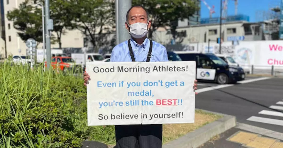 This Man Stood Outside The Tokyo Olympic Village Every Day Holding Motivational Placards For Every Athlete Competing At The Olympics
