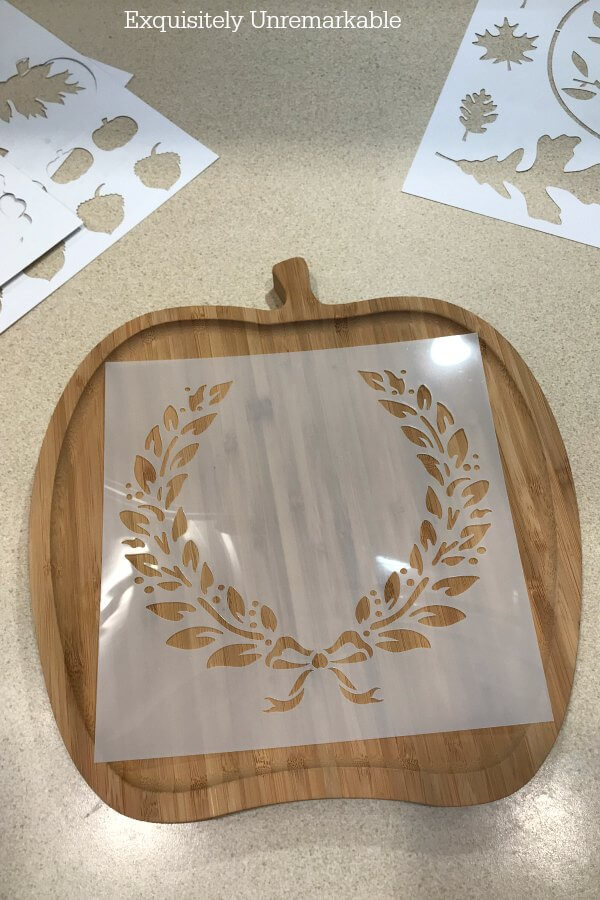 Garland Wreath Stencil on an apple shaped cutting board