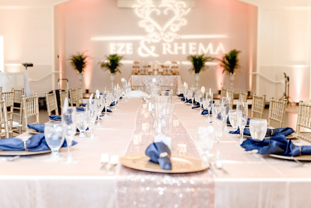 wedding reception head table at lake mary events center with navy napkins