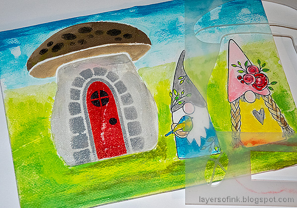 Layers of ink - Gnome Home Mixed Media Canvas Tutorial by Anna-Karin Evaldsson. Add details to the mushroom house.