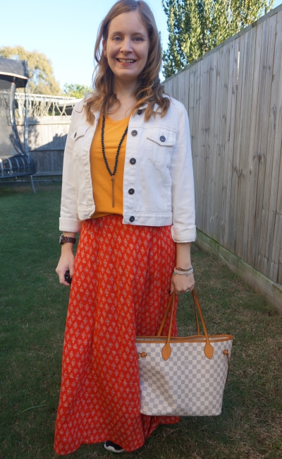 mustard tee, red maxi skirt and white denim jacket with Louis Vuitton neverfull tote | away from blue