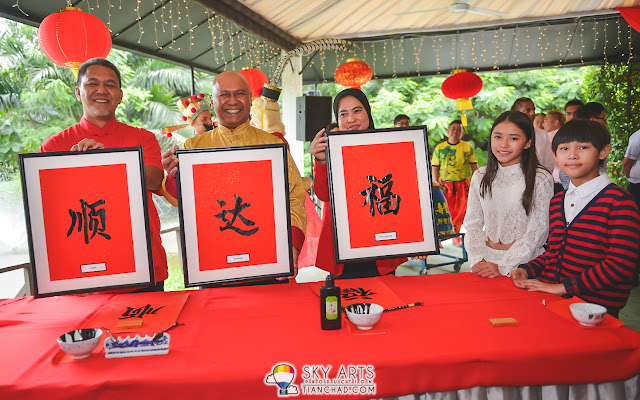 "Chinese Calligraphy in conjunction with PETRONAS CNY Launch Event ""顺。达。福"" meaning ""Safe Arrival is Prosperity"""
