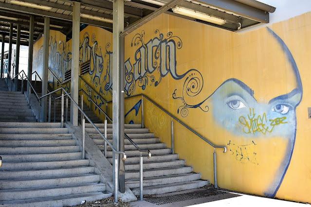 Artist Tom McDonald creates mural at Blacktown train station