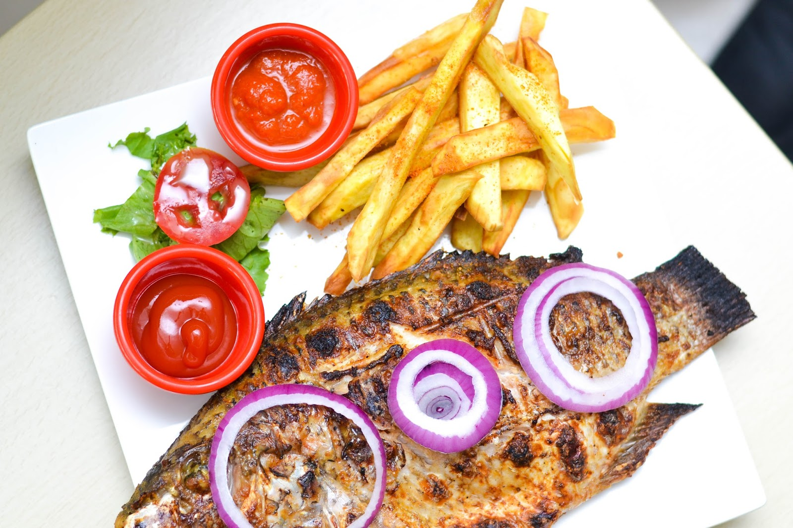 Sweet Potato Fries with Sliced Tomato, Lettuce, Ketchup and Grilled Fish