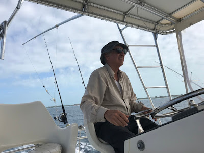 Fred driving a fishing boat