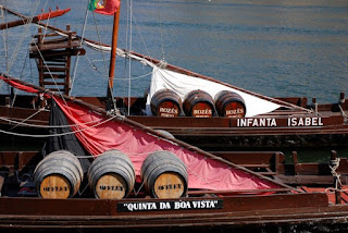 Traditional Portuguese boats carrying barrels of Port wine