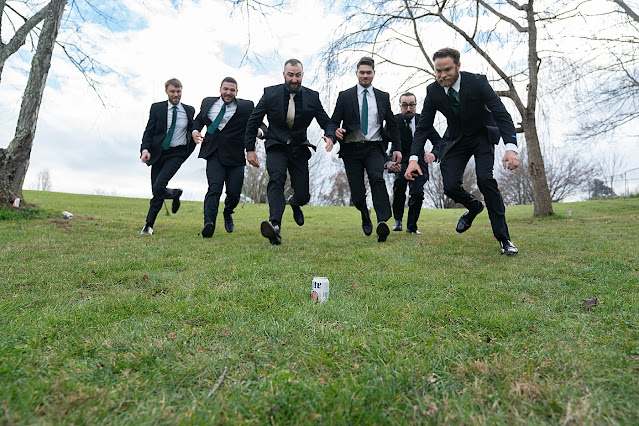 Fun Groom and Groomsmen pic with running and jumping Magnolia Farm Asheville Wedding Photography captured by Houghton Photography