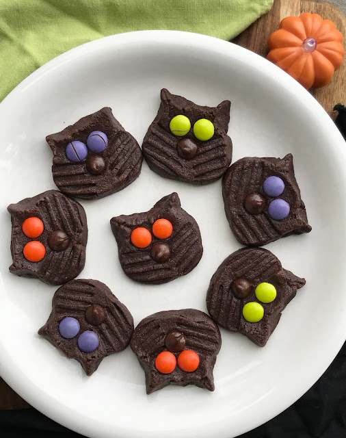 Plate of finished dark chocolate black cat cookies.