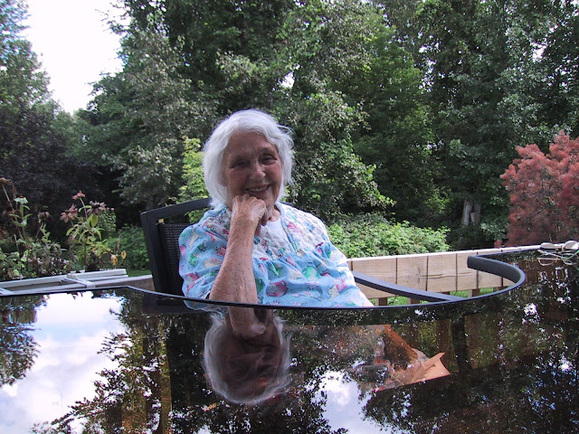 My sweet Mom, in her favourite spot where she could watch the birds