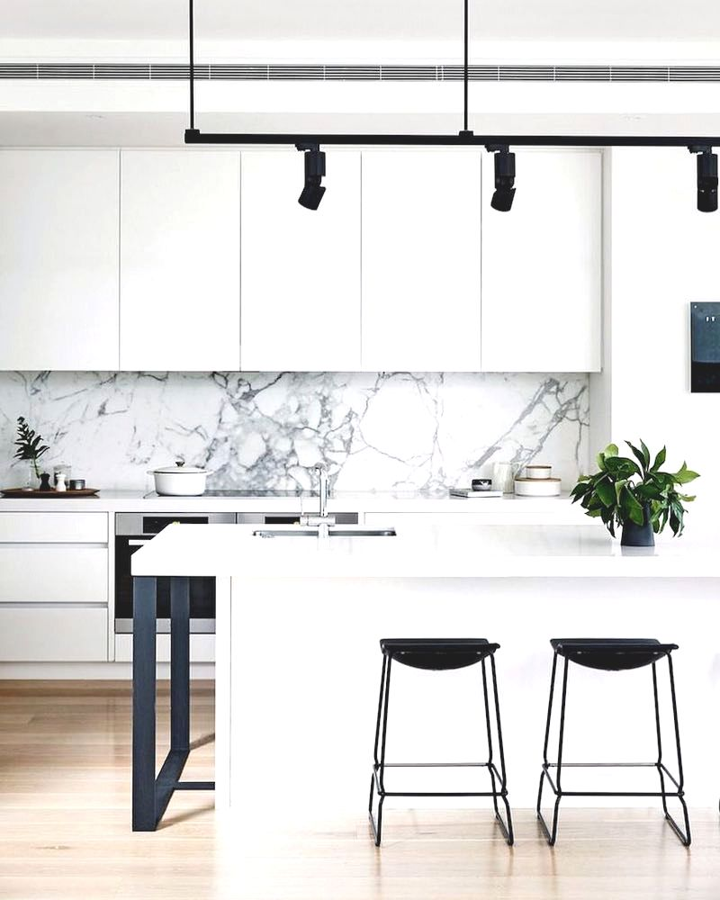 white marble kitchen of black and with backsplash via cortese architects