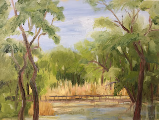 plein air in the park, trees frame a picture, green and blue