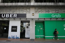 Singapura Denda Rp137 M Karena Akuisisi Uber-Grab