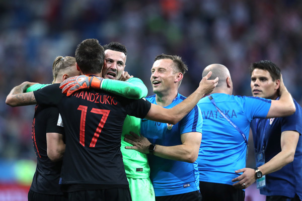 Danijel Subasic, Domagoj Vida, and Mario Mandzukic of Croatia celebrate following their sides victory in a penalty shoot out during the 2018 FIFA World Cup Russia Round of 16 match between Croatia and Denmark at Nizhny Novgorod Stadium on July 1, 2018 in Nizhny Novgorod, Russia.