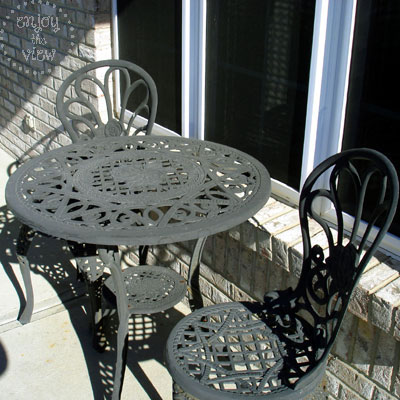 weathered wrought iron bistro set
