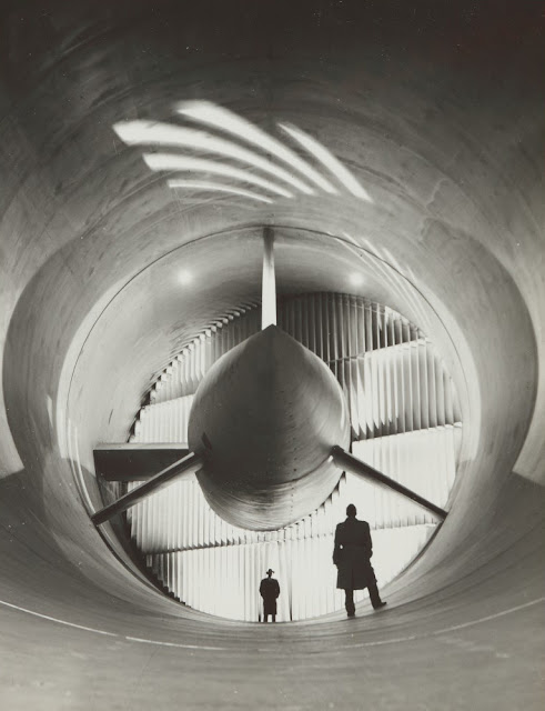 NASA photographer Bill Taub black and white photograph of two men in coats in Langley Wind Tunnel