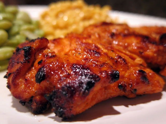 Grilled Buffalo Chicken - chicken marinated in butter, hot sauce, Worcestershire sauce, and onion powder. Seriously delicious!! Drizzle with a little ranch and you have a light and healthy meal!! #grilling #chicken