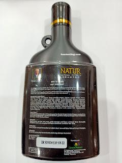 bagian belakang dari kemasan botol natur shampoo tea tree oil