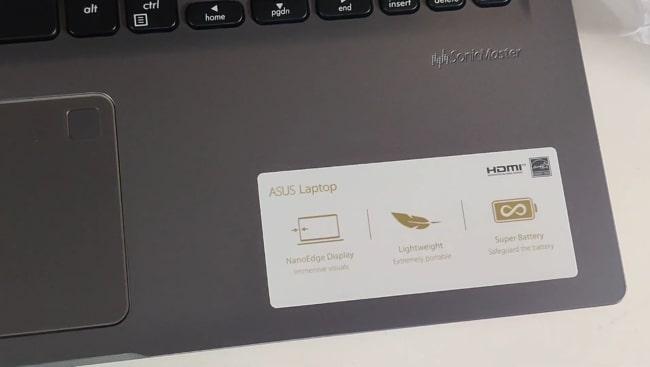 Fingerprints on the smooth matte plastic surface of Asus VivoBook 15 M515DA laptop.