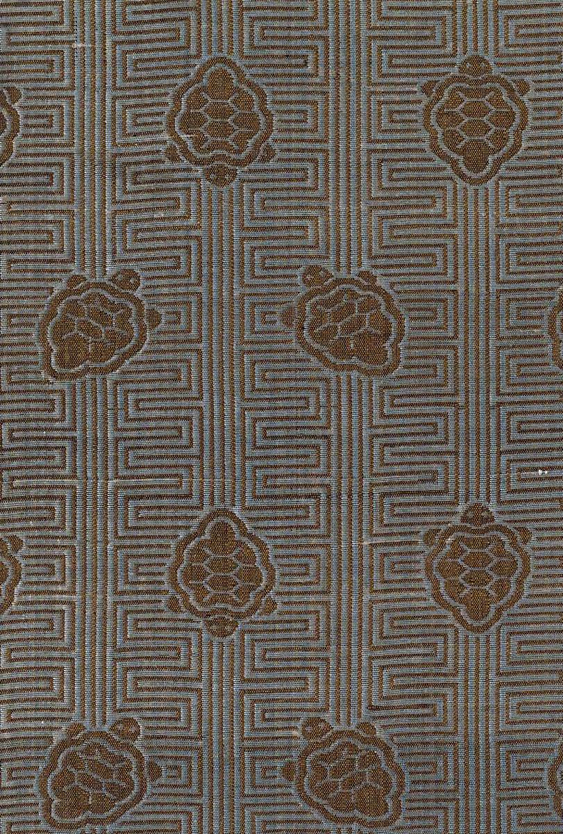 an old textile from Asia with a tuerle pattern