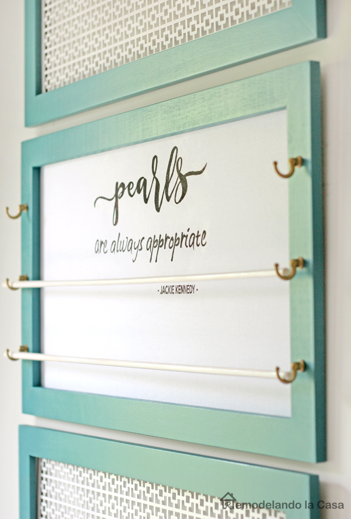 vintage teal jewelry organizer with rods to hang bracelets