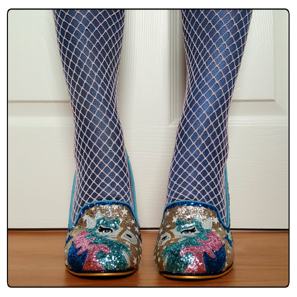 front view of glitter unicorn court shoes with blue metallic tights and fishnets