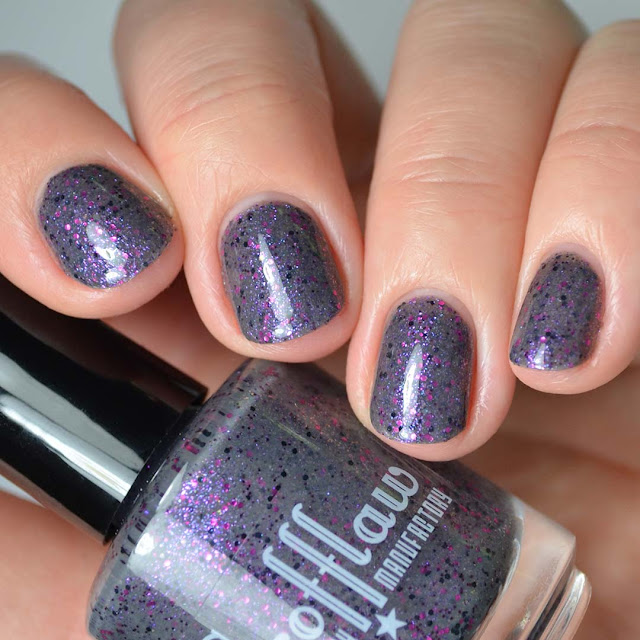 grey nail polish with purple glitter swatch