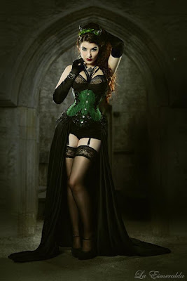 Female steampunk costume/clothing inspiration. Black showgirl skirt with green corset.