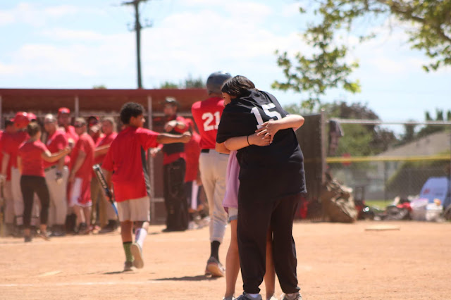 Hug after Special Olympics softball game
