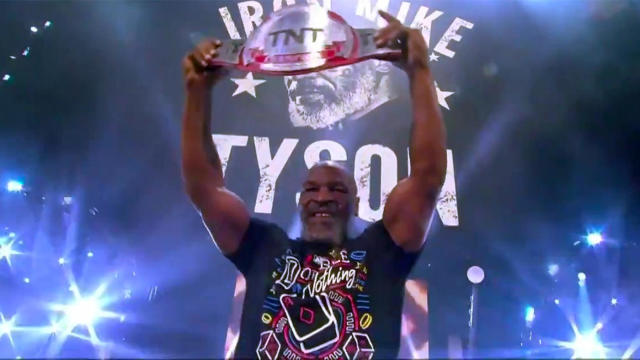 Mike Tyson rips off shirt at AEW wrestling and takes on WWE legend Jake the Snake Roberts