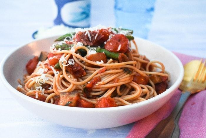 Easy Eggplant, Asparagus & Chilli Spaghetti in a white bowl