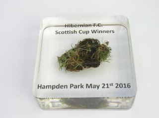 Paperweight containing a piece of Hampden Park turf