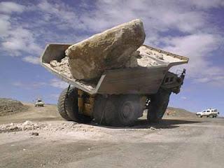 big rock in giant dump truck