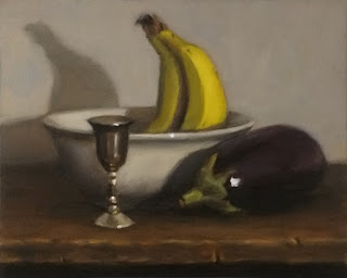 Still life oil painting of an eggplant, a small silver-plated goblet and two bananas in a white bowl.