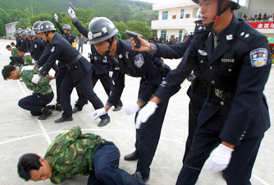 Chinese officers demonstrating execution procedure