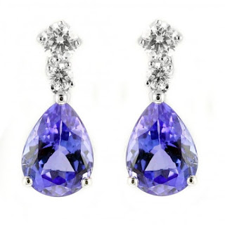 Image showing drop earrings in white gold featuring 2.40ct of the purple blue stone tanzanite and diamonds. Price two and  half thousand pounds.