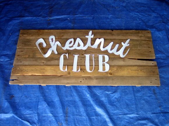 painting an old pallet sign