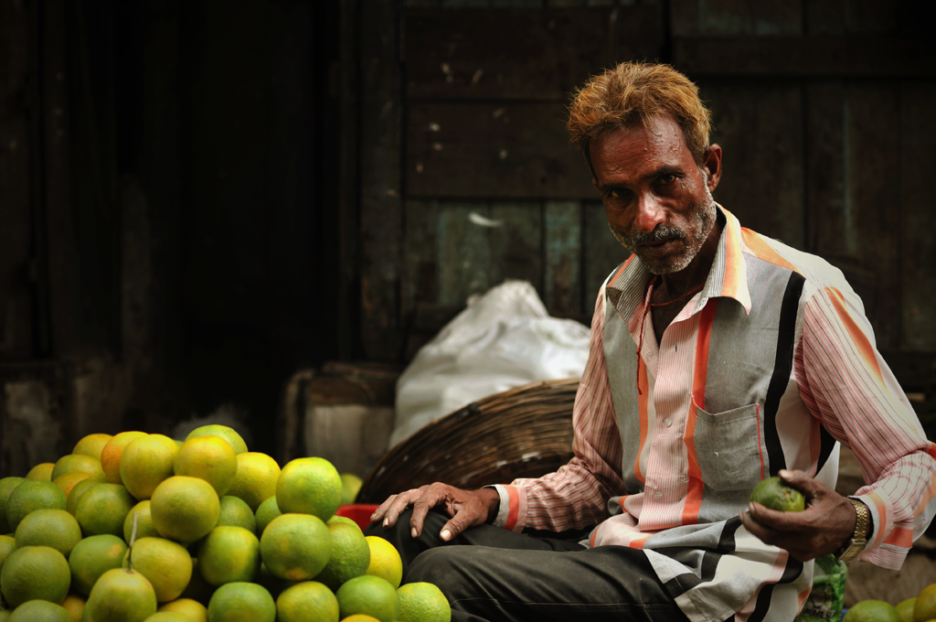 Picture of an Indian man with vegetables in the Byculla area of Mumbai in India.