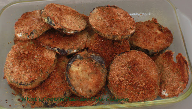 these are a baked eggplant chips and in a glass dish baked