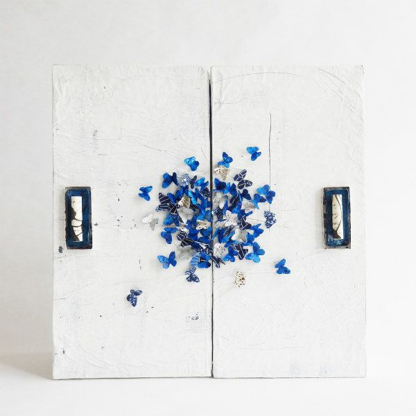 handmade remembrance box with blue paper butterflies on top