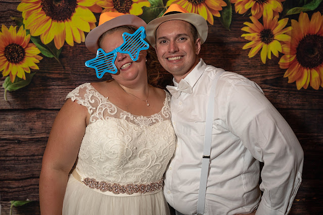 Goofy shot of Bride and Groom with sunflower background Magnolia Manor Wedding Photos by Stuart Wedding Photographer Heather Houghton Photography