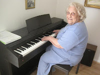 Senior Citizen playing digital piano