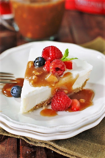 Cheesecake Topped with Fresh Berries and Easy Toffee Sauce Image