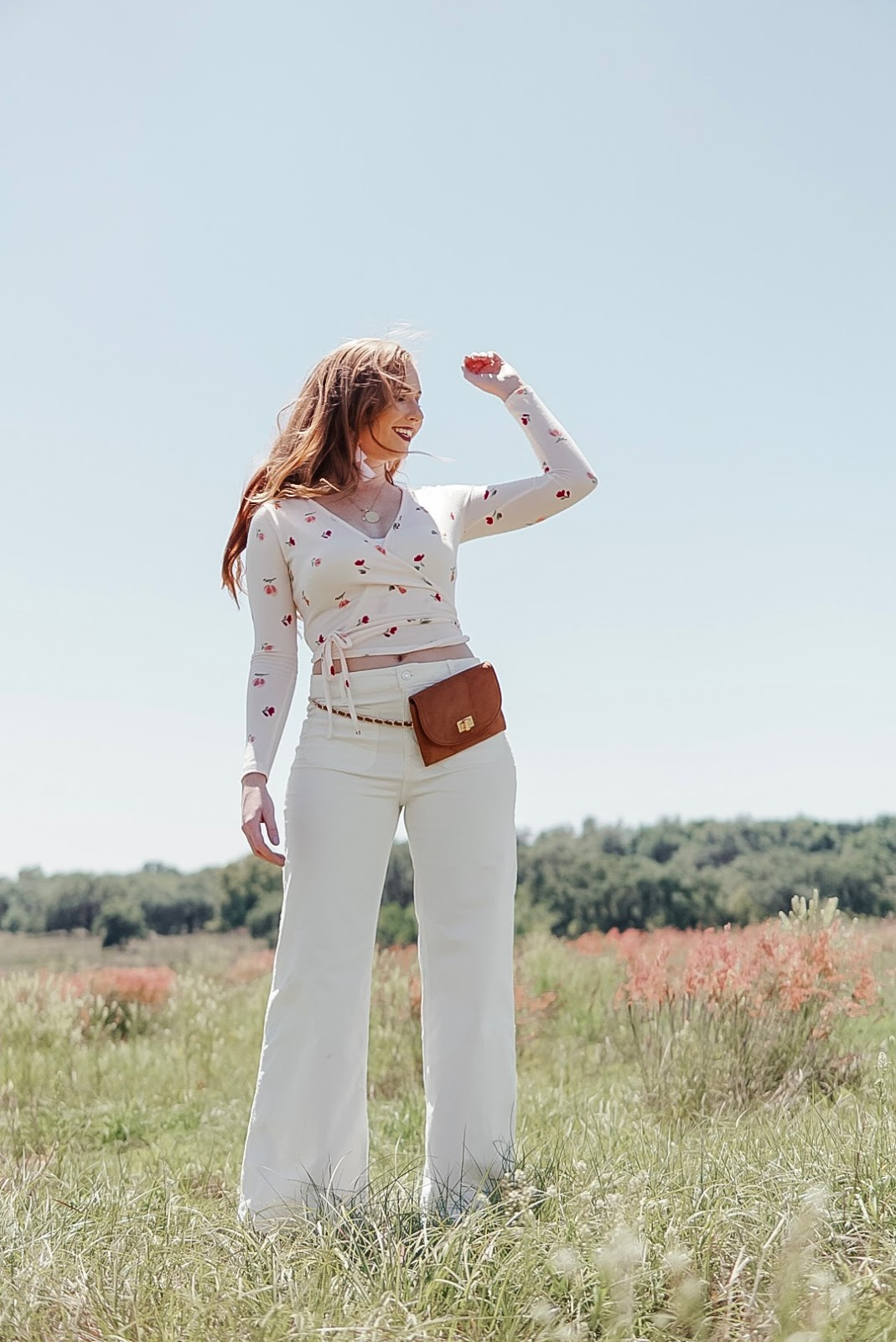 affordable by amanda: how to style 70s trends for spring this season. wearing a floral printed tulip long sleeve top in pink from forever 21 and white corduroy pants from forever 21.