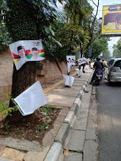 Survey Unggulkan Jokowi, Ratusan  Baliho Jokowi Maruf di Rusak