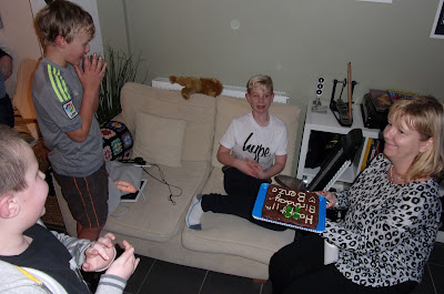 helicopter mummy blowing out candles for her own kid