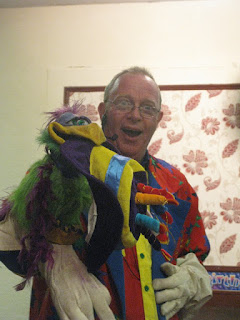 Picture of magician with 'exotic' bird of prey