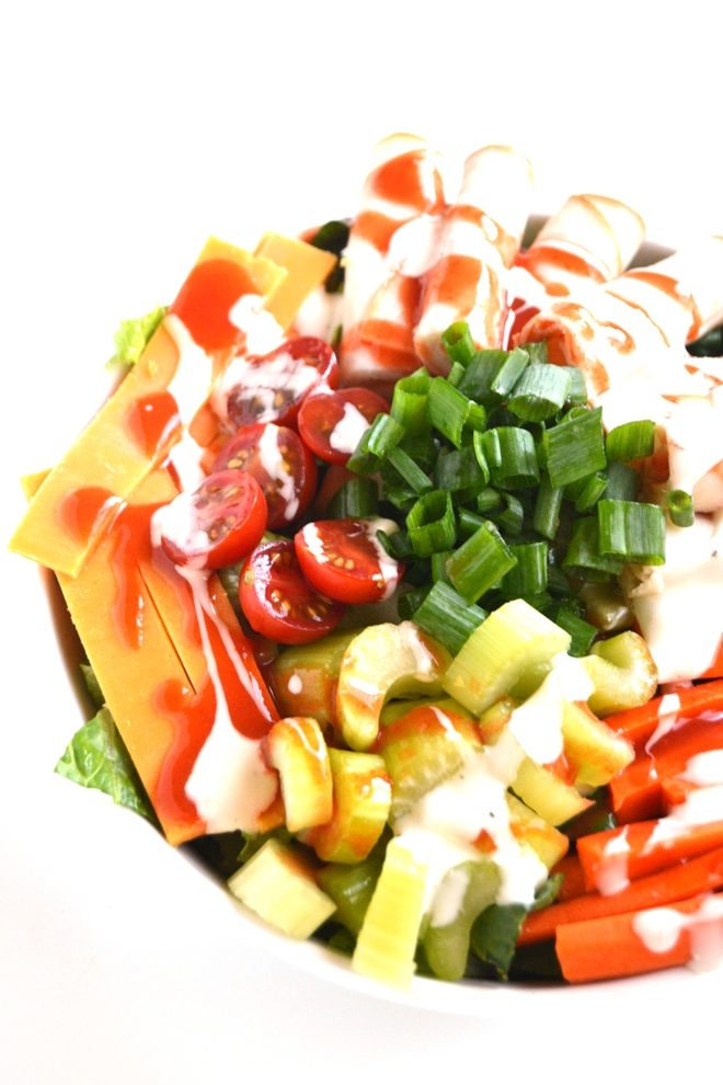 Loaded Buffalo Chicken Salad is a simple salad that requires no cooking, is ready in 10 minutes and is full of flavor with hot sauce, blue cheese dressing and delicious vegetables! www.nutritionistreviews.com