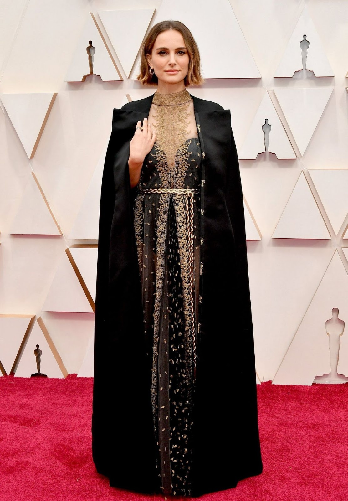 Natalie Portman shows her support for the female directors snubbed by the Oscars by wearing a Dior cape embroidered with the names of every woman who wasn't nominated including Greta Gerwig and Lulu Wang
