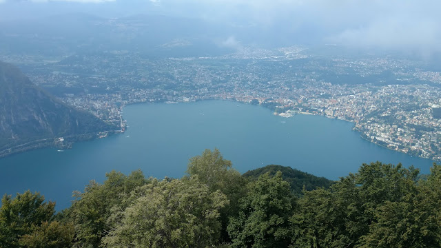 The city of Lugano, on Lake Lugano